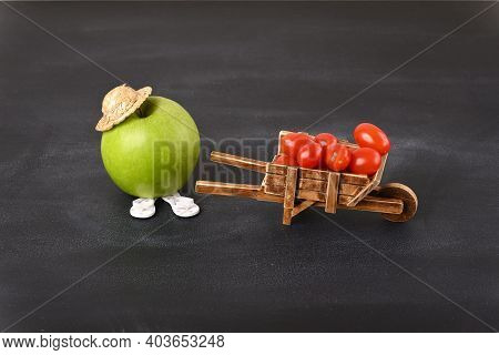 An Apple And Antique Barrow With Cherry Tomatoes, Conceptual Photo.