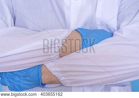Cropped Closeup Photo Of Professional Doctor In Gloves Standing With Folded Crossed Arms