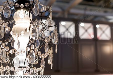 Crystal Strass Lamp White Over Blurred Background, Luxury Interior Design.luxurious Crystal Chandeli