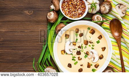 Delicious Cream Soup, Made Of Mushrooms With Croutons On A Wooden Background. Top View. Copy Space.