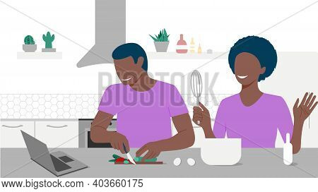 Happy Black Couple Looks On Laptop And Cooking By Online Video Tutorial In Their Kitchen. Online Cul