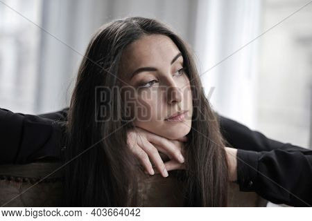 portrait of woman with melancholy expression