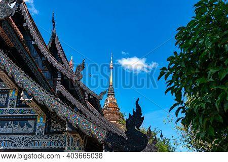 Pagoda And Lanna Style Dark Wooden Church At Wat Lok Molee In Chiang Mai Province Thailand