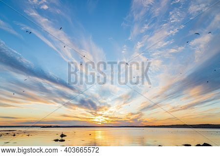 Sunrise Sky Reflection Over A Sea. Amazing Cloudy Sunset Over The Sea. Colorful Sunset Over Water Su
