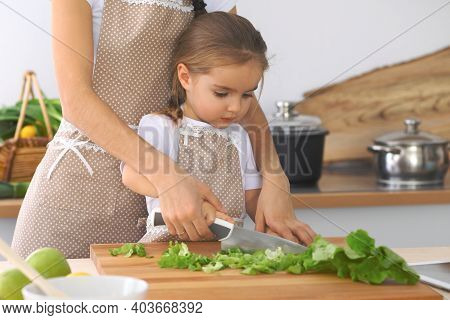 Mother And Little Daughter Cooking Tasty Breakfast Of Fresh Salad. Little Helper Slicing And Mixing