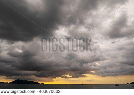 Dark Storm Cloud Over The Sea In Sunset Or Sunrise Sky Dramatic Black Cloudscape.