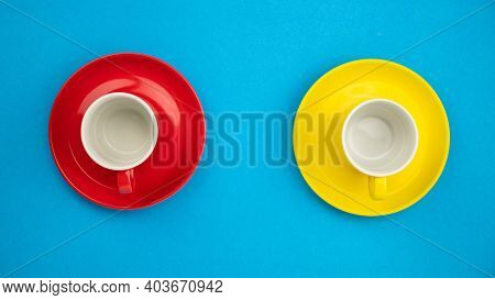 Top View Colorful Coffee Cup On Blue Paper Background