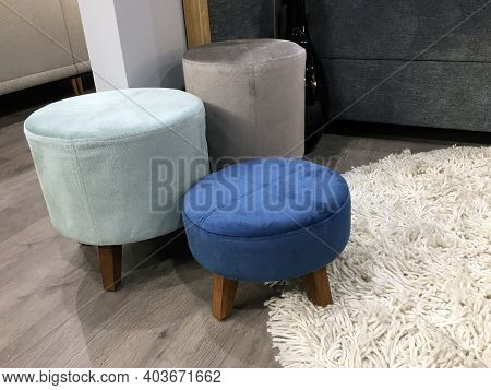 Soft Ottomans On Wooden Legs In The Bedroom. Soft Backless Stool. White Thread Carpet. Stylish Home