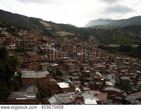 Panorama Cityscape Of Colorful Brick Houses In Comuna 13 San Javier Neighborhood Poverty Slum In Med