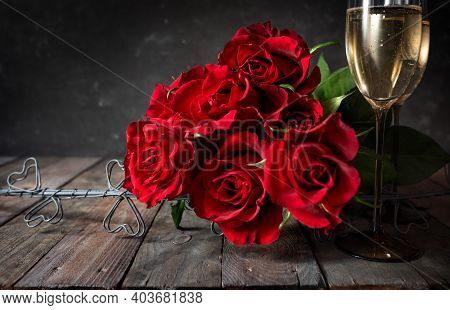 Love Symbol Red Roses With Champagne Dekorated On Dark Wooden Vintage Planks. Romantic Still Life Fo
