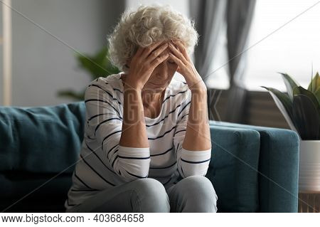 Unhealthy Old Senior Retired Woman Suffering From Strong Headache.