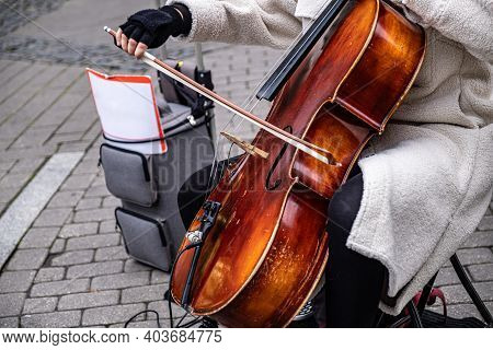 A Street Musician Makes Money For Lunch. The Musician Plays In The Street.