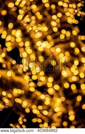 Blurred Festive Christmas Background. Abstract Background With Bokeh Defocused Yellow Lights.