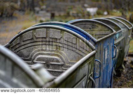 A Row Of Galvanized Trash Containers. Garbage Containers In The Park.