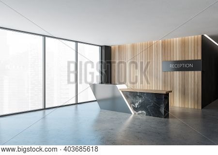 Black And Wooden Reception Room, Grey And Dark Marble Desk On Grey Floor Near Big Windows, Side View