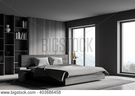 Corner Of Modern Master Bedroom With Gray And Wooden Walls, Concrete Floor, Comfortable King Size Be