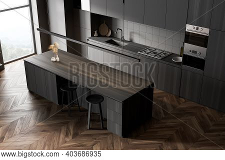 Top View Of Modern Kitchen With Gray And Wooden Walls, Wooden Floor And Grey And Wooden Cupboards. W