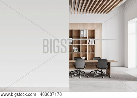Interior Of Modern Office Meeting Room With White And Wooden Walls, Concrete Floor And Long Conferen