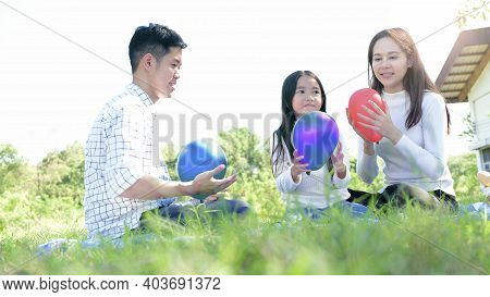 Asian Portrait Family Trip Father Mother And Daughter Enjoy Relaxation Playing Balloons With Family