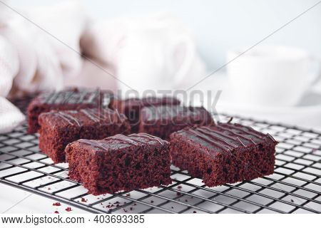 Chocolate Brownie And A Cup Of Tea On The Backing Rack