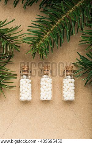 Homeopathic Pills With Pine Tree On Cork Background. Homeopathy, Naturopathy And Alternative Medicin