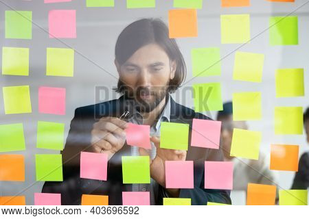 Concentrated 30s Caucasian Businessman Managing Working Tasks.