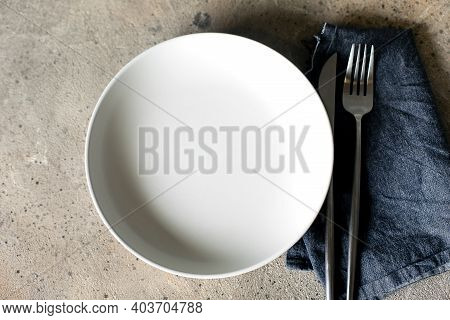 Table Setting Background. Light Plate On Stone Table With Blue Jeans Tablecloth. Place For Text, Cop