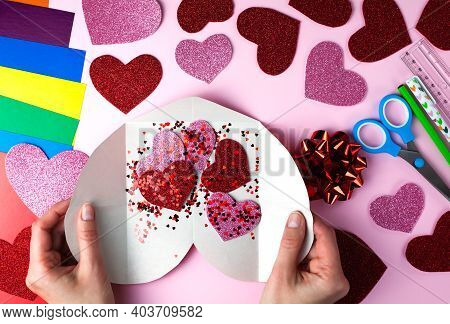 Woman's Hands Holds A Big And Small Paper Hearts For Valentine's Day Card. Diy Concept For Valentine