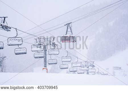 Empty Ski Slopes And Ski Lifts In Ski Resort. During The Winter Holidays 2021 January Lifts Are Clos