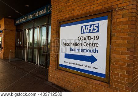 Editorial, Sign To Entrance Of Nhs Covid-19 Vaccination Centre At The Main Entrance Of Bournemouth I