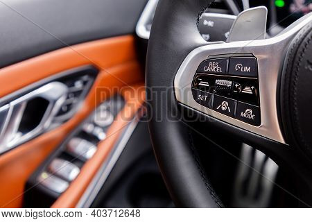 Buttons On Steering Wheel In Interior Of A Car