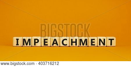 Impeachment Symbol. Wooden Cubes With The Word 'impeachment'. Beautiful Orange Background, Copy Spac