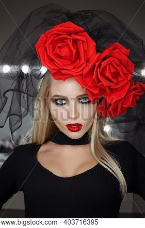 Attractive Goth Female With Bright Makeup Wearing Amazing Rose Headgear And Looking At Camera