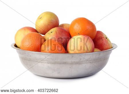 Metal plate with ripe fruits. Isolated object on white background