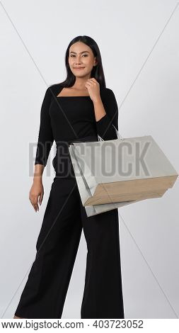 Shopping. Confident And Sexy Young Asian Woman Happily With Shopping Bag