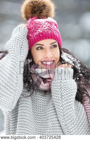 Trendy Winter Fashion Outfit On A Beautiful Woman Wearing Sweater, Scarf And Pom Pom Hat.