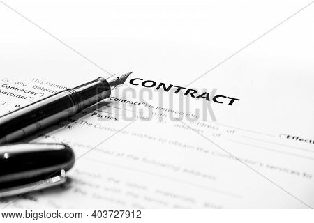 Close-up Of A Fountain Pen On Docunent Contract. Legal Contract Signing, Buy Sell Real Estate Contra