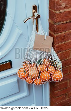 Reusable String Bag From Environmentally Friendly Materials With Citrus Fruits And Blank Card Hangin