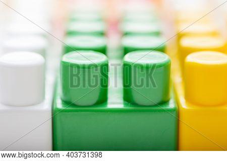 Plastic Building Blocks Background. Colorful Toy Bricks For Kid. Colorful Construction Blocks Backgr