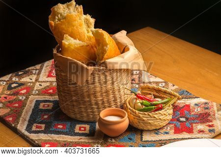 Fresh Georgian Pastries - Bread And Pita Bread In A Basket. Different Types Of Baked White Bread, Sa
