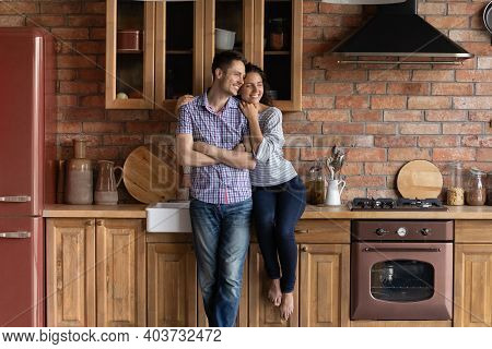 Happy Couple Renters Relax In Own Renovated Kitchen