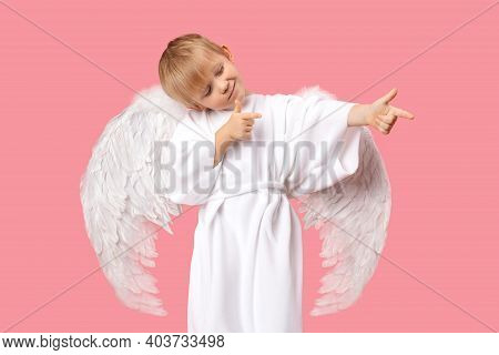 Angel Cherub Child Boy With Large White Wings Is Aiming At Man To Make Him Fall In Love. Studio Shot
