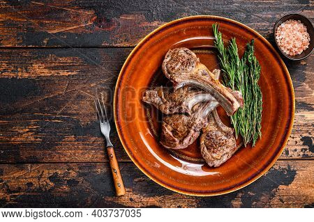 Bbq Grilled Lamb Mutton Meat Chops Steaks On A Plate. Dark Wooden Background. Top View. Copy Space