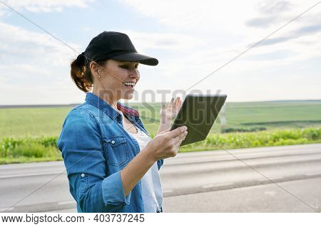 Smart Farming And Digital Agriculture, Female Agricultural Worker With Digital Tablet In The Country