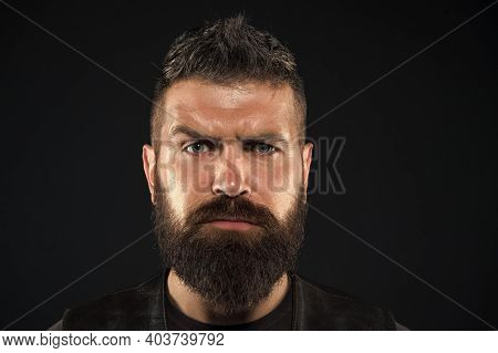 Facial Hair. Male Face. Handsome Face. Fashion Model. Man With Beard In Black Leather Clothes. Man C