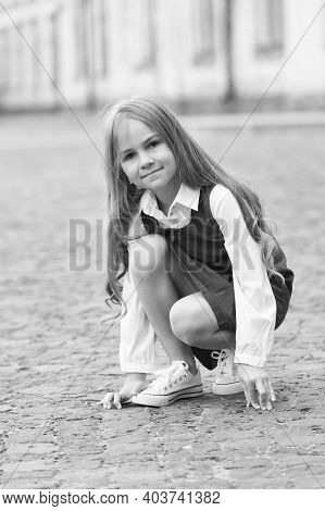 Little Child With Long Hair In School Uniform Play In Schoolyard Outdoors, Childhood.