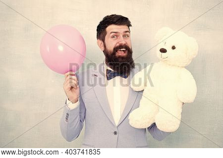 Greetings 8 March. Celebrate Love. Valentines Day. Romantic Man With Teddy Bear And Air Balloon Wait