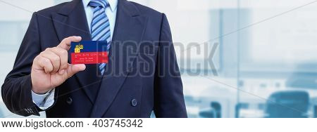Cropped Image Of Businessman Holding Plastic Credit Card With Printed Flag Of Liechtenstein. Backgro