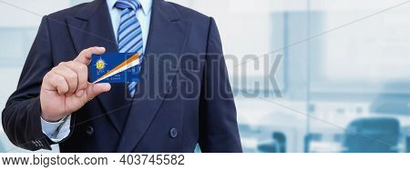 Cropped Image Of Businessman Holding Plastic Credit Card With Printed Flag Of Marshall Islands. Back