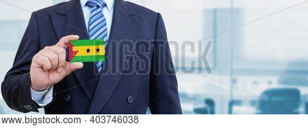 Cropped Image Of Businessman Holding Plastic Credit Card With Printed Flag Of Sao Tome And Principe.